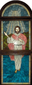 Stained glass Jesus behind church altar